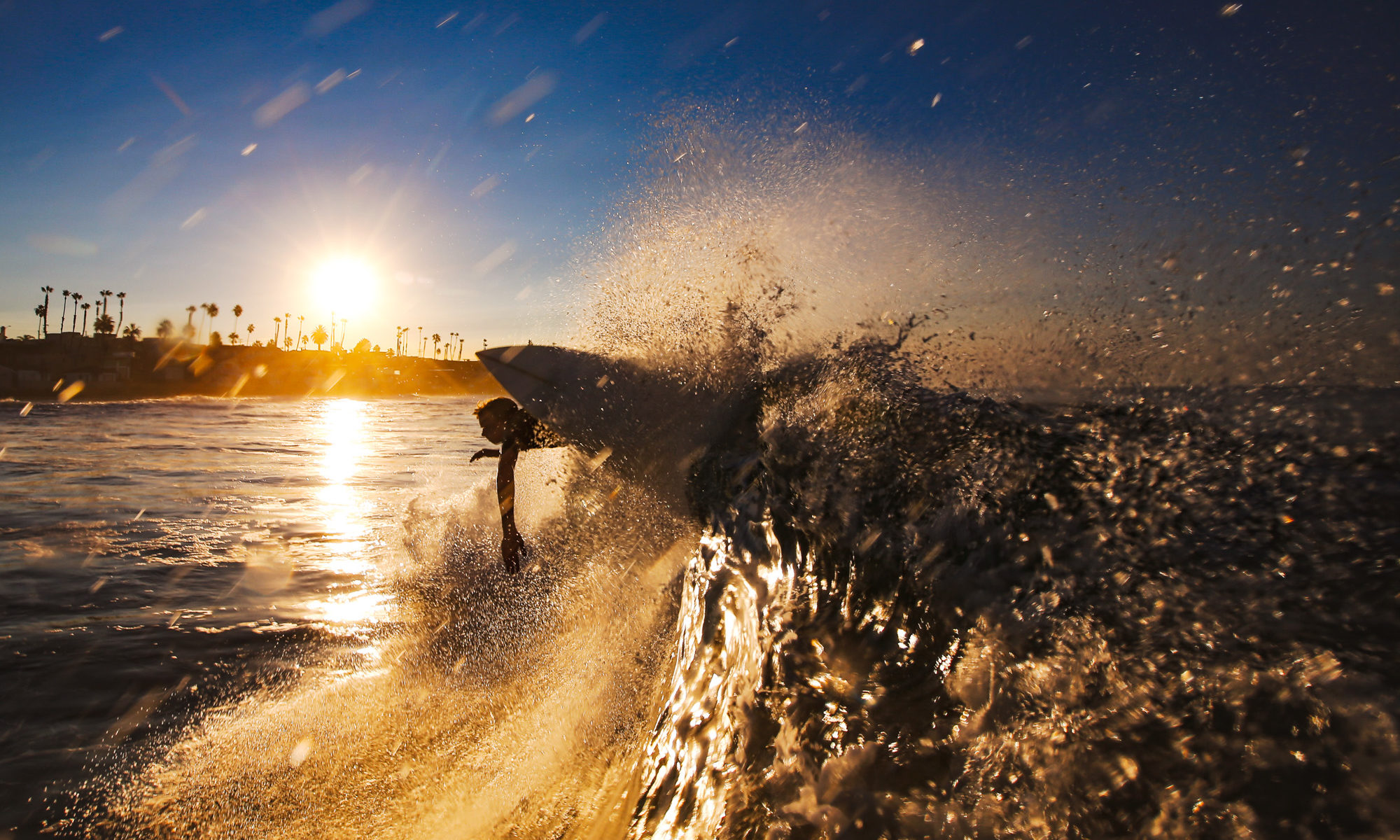 Water shot of a surfer at sunrise during a personal surf photographer session in Oceanside, California. Photo by Mark Johnson/Ironstring