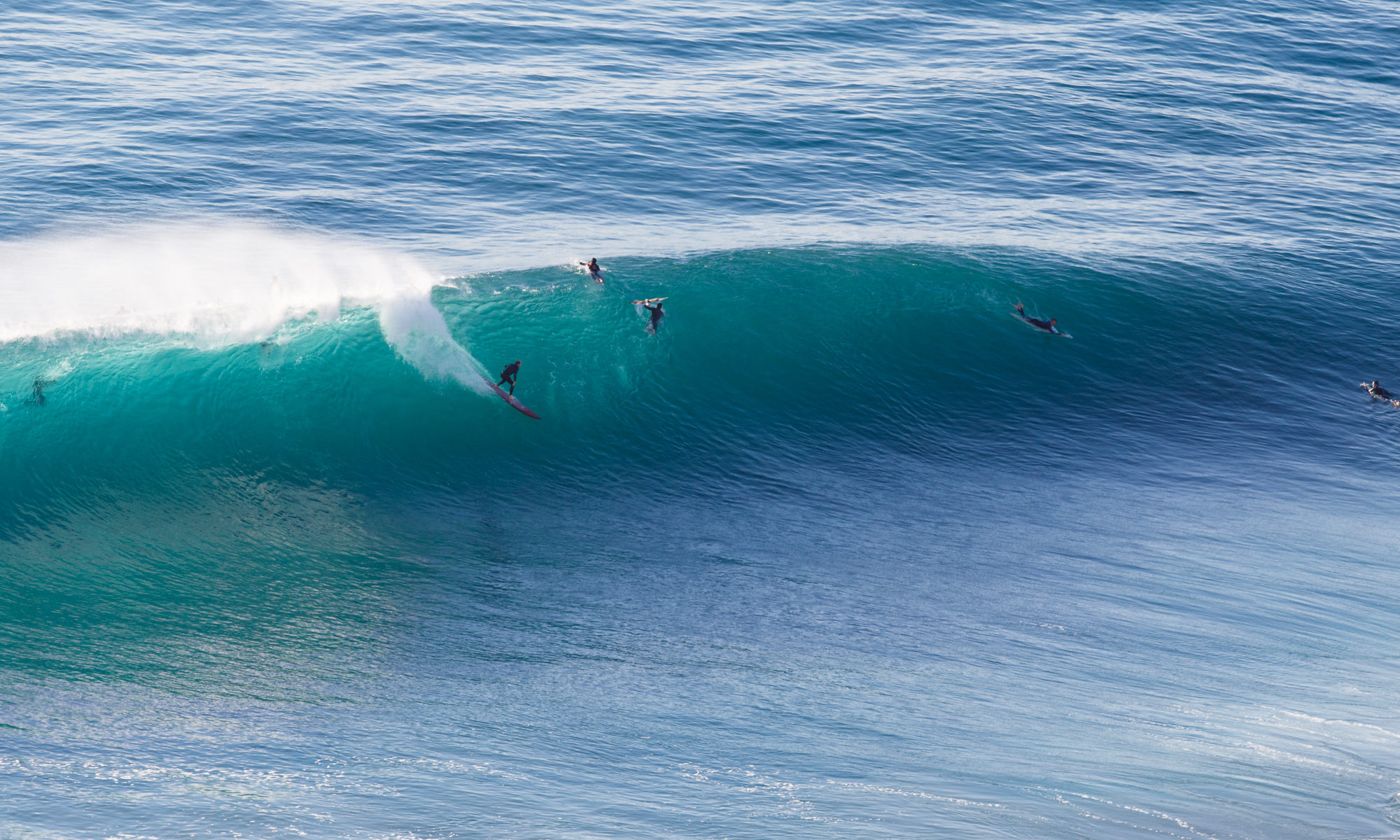 A surfer on a big wave at Blacks Beach by Mark Johnson/Ironstring